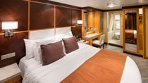Suite con Cuatro Dormitorios Familiar y Balcón